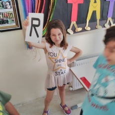 1st graders played game about English alphabet and numbers